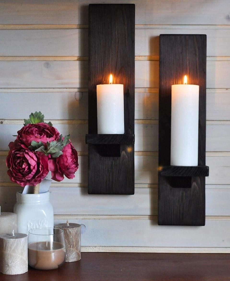 <p>These <span>Wall Mount Rustic Candleholders</span> ($42) will make your home feel cozy.</p>
