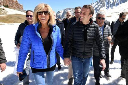 Emmanuel Macron, head of the political movement En Marche !, and his wife Brigitte Trogneux arrive for a lunch break at the mountain top during a campaign visit in Bagneres de Bigorre