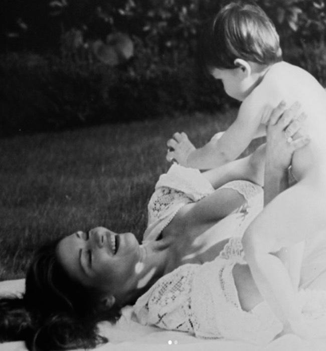 Catherine zeta-jones plays with her son Dylan in old black-and-white photo