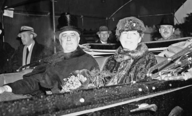 President and First Lady Roosevelt brave the wretched weather in an open-air limo during the inaugural parade in 1937.
