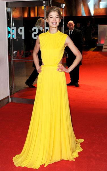 <b>Rosamund Pike </b><br><br>The Jack Reacher star brought some sunshine to the red carpet in this Alexander McQueen Spring 2013 gown.<br><br>© Rex