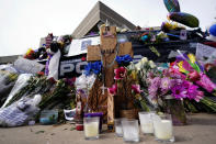 Tributes surround a police cruiser placed in honor of fallen officer Eric Talley outside the Boulder Police Department Thursday, March 25, 2021, in Boulder, Colo. Officer Talley and 9 others were killed in a shooting at a supermarket on Monday. (AP Photo/David Zalubowski)