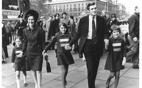 Cecil Parkinson arrives at the House of Commons as MP for Enfield West with his family following his victory in a by-election in 1970 - Credit: Hulton Deutsch/Corbis Historical