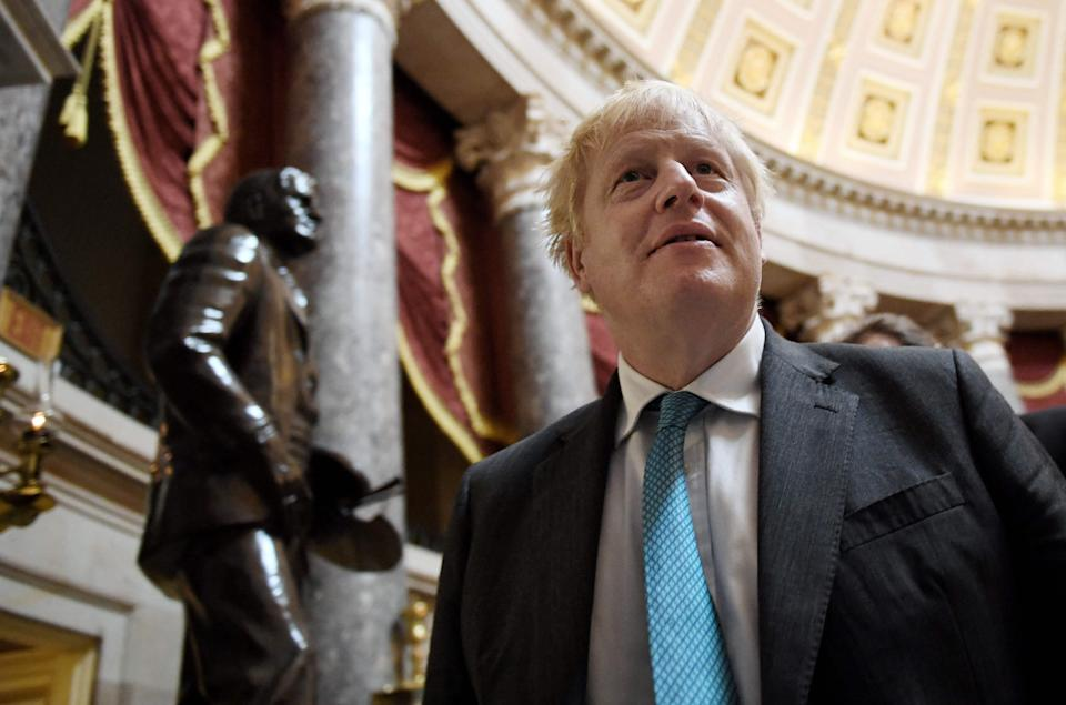 Boris Johnson issued his plea to Macron after visiting the US Capitol in Washington on Wednesday  (AFP via Getty Images)