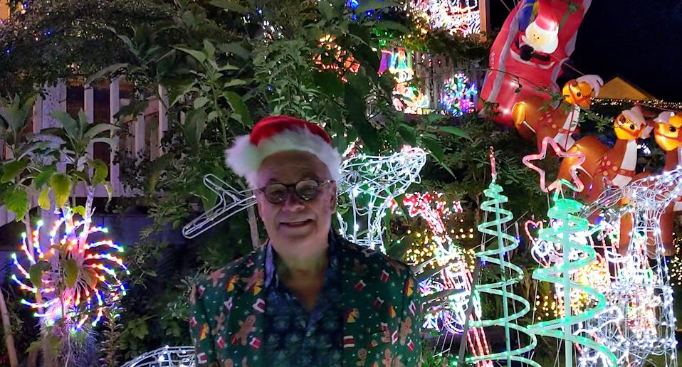 Mark Buckle at his Richards Close residence in front of his impressive Christmas light display.