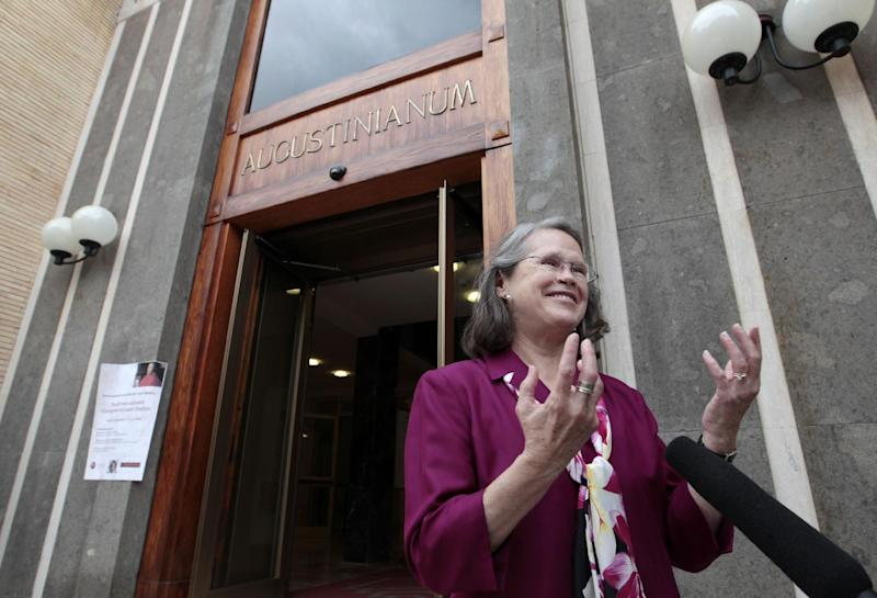 Karen King, a professor at Harvard Divinity School, is interviewed outside the Augustinianum institute where an international congress on Coptic studies is held in Rome, Wednesday, Sept. 19, 2012. Scholars are questioning the authenticity and significance of a much-publicized discovery by a Harvard scholar who reported that a 4th Century fragment of papyrus has provided the first evidence that some early Christians believed Jesus was married. Karen King announced the finding Tuesday at an international congress on Coptic studies in Rome. Her paper, and the front-page attention it received in some U.S. newspapers, was very much a topic of conversation during the coffee breaks at the conference Wednesday. (AP Photo/Gregorio Borgia)