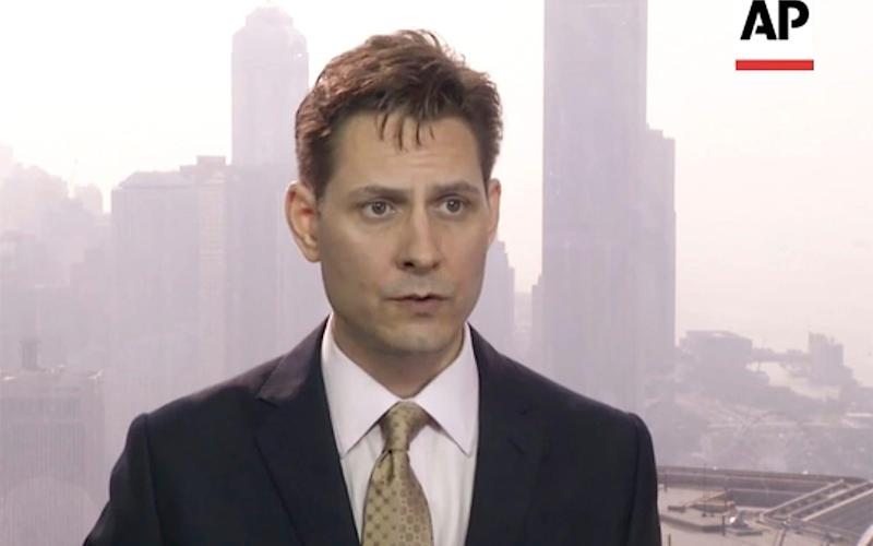 Michael Kovrig was working for the International Crisis Group when he was detained - AP