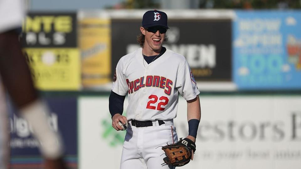 Mets prospect Brett Baty holding ball, smiling while playing for Brooklyn Cyclones