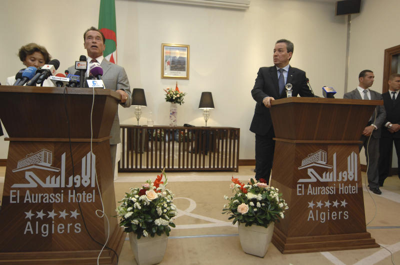 Former California Governor Arnold Schwarzenegger, left, now president of NGO R20 speaks during a press conference with Algerian minister for Urban Affairs, Territory and Environment Amara Benyounes in Algiers, Tuesday, June 25, 2013. Schwarzenegger founded R20, a coalition of partners led by regional governments that work to promote and implement projects that are designed to produce local economic and environmental benefits in the form of reduced energy consumption and greenhouse gas emissions. The R20 will open an office in Algeria. (AP Photo/Sidali Djarboub)