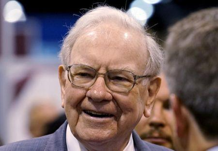 FILE PHOTO: Berkshire Hathaway CEO Buffett talks to reporters prior to the Berkshire annual meeting in Omaha