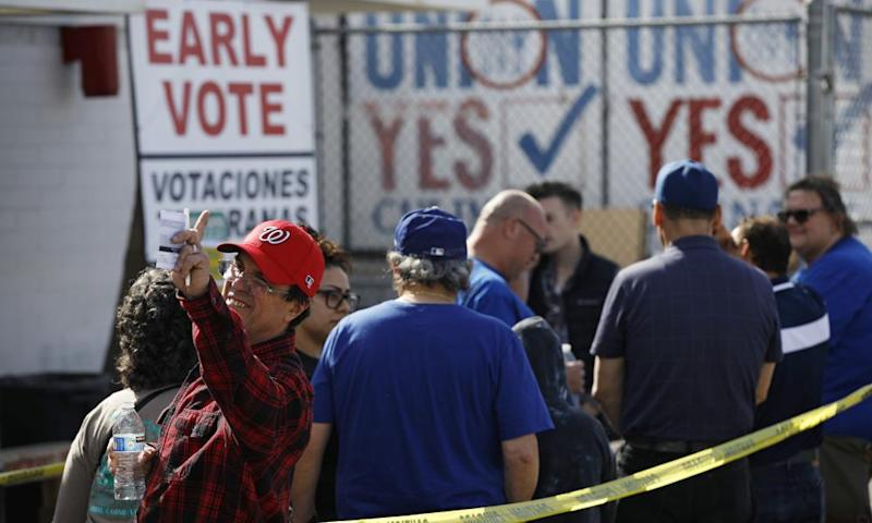 People wait in line to vote early at the Culinary Workers union in Las Vegas on Monday.