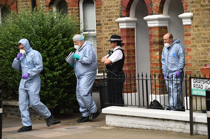 File photo dated 15/8/2018 of orensics and a police officer at the home of Simonne Kerr in Battersea, south-west London after her death. Former soldier Desmond Sylva has admitted at the Old Bailey of killing the nurse who performed on Britain's Got Talent in an NHS choir.