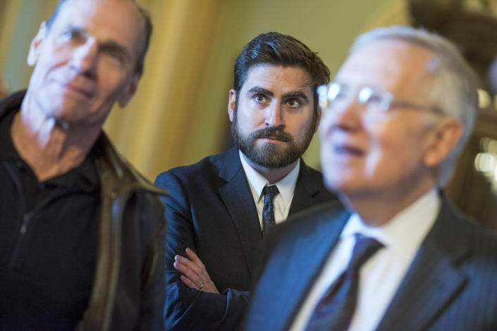 Adam Jentleson, center, appears with his boss Senate Minority Leader Harry Reid, D-Nev., right, and artist Michael Heizer, before an easement signing ceremony in the Capitol to help protect Nevada's Basin and Range National Monument that contains Heizer's modern art sculpture