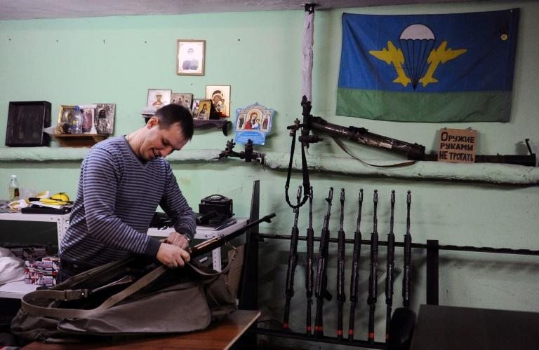Denis Gariyev, a member of the Russian Imperial Movement who along with the group was designated as a terrorist by the US State Department, holds a weapon simulator at a training base in Saint Petersburg in 2015