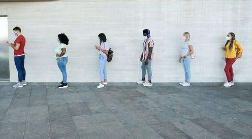 "<span class=""attribution""><a class=""link rapid-noclick-resp"" href=""https://www.shutterstock.com/image-photo/multiracial-people-standing-queue-waiting-young-1763599409"" rel=""nofollow noopener"" target=""_blank"" data-ylk=""slk:Sabrina Bracher/Shutterstock"">Sabrina Bracher/Shutterstock</a></span>"