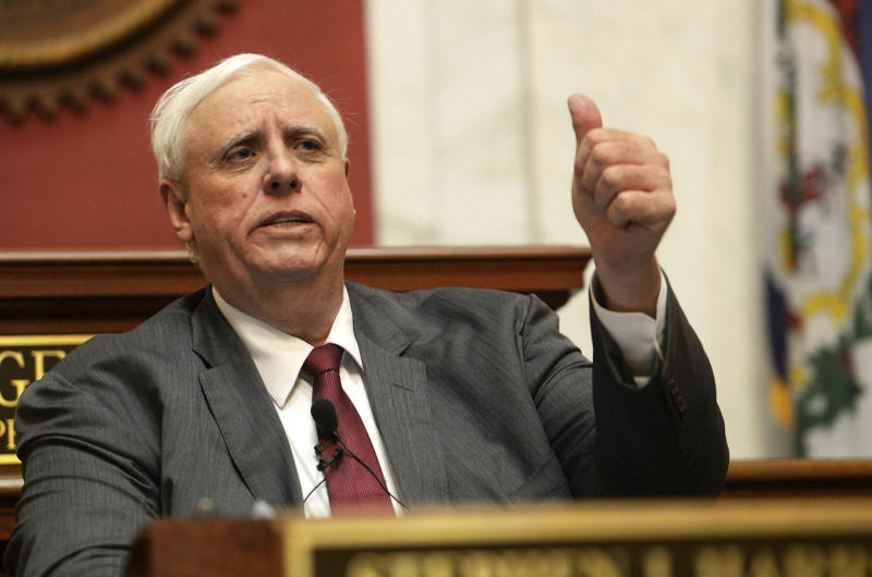 File-This Jan. 9, 2019, file photo shows West Virginia Gov. Jim Justice delivering his State of the State address in the House of Delegates' Chamber in Charleston, W.Va. A lawsuit seeking to force Justice to live in the state capital is expected to be back in court. A hearing in the case brought by Democratic Del. Isaac Sponaugle is scheduled for Wednesday, Aug. 21, 2019, in Charleston. (Chris Dorst/Charleston Gazette-Mail via AP, File)
