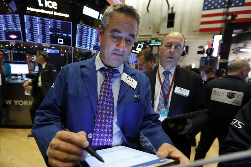 Traders Daniel Trimble, left, and Gordon Charlop work on the floor of the New York Stock Exchange, Friday, Dec. 13, 2019. After months of waiting, markets had a muted reaction to news Friday that the US and China had reached an initial deal on trade. (AP Photo/Richard Drew)