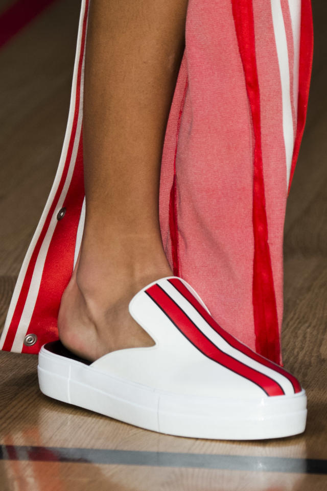 <p><i>Red-striped mule sneakers from the SS18 Monse collection. (Photo: ImaxTree) </i></p>