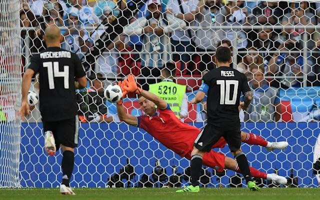 """As the final whistle blew, Lionel Messi angrily volleyed the ball high into the Moscow air before kneeling down in the centre-circle to be consoled by a steady succession of team-mates. They must have secretly wished that he had struck his penalty with such venom. Argentina looked and felt for all the world like losers and, while Messi's 64th minute missed penalty provided just about the ultimate personal contrast to Cristiano Ronaldo's hat-trick in Sochi against Spain, he might at least find some consolation in his great rival's story story at Euro 2016. Portugal had also begun with a stodgy and frustrating 1-1 draw against an easily underestimated Iceland team but would ultimately still leave France victorious by the end of the tournament. It is a lesson that should at least provide some perspective amid the temptation to suggest that Ronaldo has already struck some of knockout blow in any personal World Cup duel with Messi, even if round one has belonged so emphatically to the Portuguese. Time had almost stood still in Sochi on Friday as Ronaldo drew several deep breaths and settled himself before delivering the free-kick that completed both his hat-trick and further ignited this World Cup. As well as the tame penalty that was saved here by Iceland goalkeeper Hannes Halldorsson, Messi also wasted a flurry of comparable late opportunities with free-kicks. """"It would have changed the script - obviously it hurts me to have missed the penalty,"""" said Messi. """"We have the bitterness of not being able to take the three points that we deserved. They did not want to play but closed well."""" Even the presence of Diego Maradona excitedly urging his team on and sucking a cigar in one of the executive boxes directly in front of a sign reminding fans about the stadium smoking ban could not sufficiently inspire Argentina. It is early days but, with further tricky group matches to follow against Croatia and Nigeria, you have to wonder if the collective scars from a succession of int"""