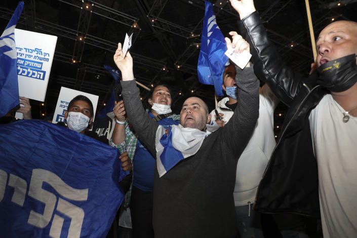 Israeli Prime Minister Benjamin Netanyahu's supporters celebrate after first exit poll results for the Israeli elections at his party's headquarters in Jerusalem, Tuesday, March. 23, 2021. (AP Photo/Ariel Schalit)