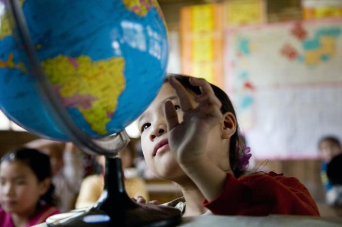 """<span class=""""caption"""">The planet and the way we live on it are constantly changing.</span> <span class=""""attribution""""><a class=""""link rapid-noclick-resp"""" href=""""https://www.gettyimages.com/detail/photo/china-guangxi-province-girl-looking-at-globe-in-royalty-free-image/200512222-001"""" rel=""""nofollow noopener"""" target=""""_blank"""" data-ylk=""""slk:Buena Vista Images via Getty Images"""">Buena Vista Images via Getty Images</a></span>"""