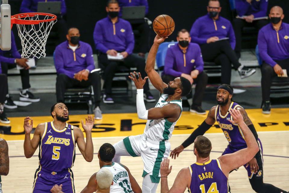 Boston Celtics' Jaylen Brown (7) shoots against the Los Angeles Lakers during the first half of an NBA basketball game Thursday, April 15, 2021, in Los Angeles. (AP Photo/Ringo H.W. Chiu)