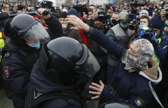 Police detain a man during a protest against the jailing of opposition leader Alexei Navalny in Moscow, Russia, Saturday, Jan. 23, 2021. Russian police on Saturday arrested hundreds of protesters who took to the streets in temperatures as low as minus-50 C (minus-58 F) to demand the release of Alexei Navalny, the country's top opposition figure. (AP Photo/Pavel Golovkin)
