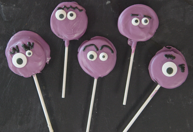 """<p>Your little monsters will love making <em>and</em> eating these easy chocolate-dipped Oreo cookie pops!</p><p><strong><em><a href=""""https://www.womansday.com/food-recipes/food-drinks/recipes/a60436/oreo-monsters/"""" rel=""""nofollow noopener"""" target=""""_blank"""" data-ylk=""""slk:Get the Oreo Monster Pops recipe."""" class=""""link rapid-noclick-resp"""">Get the Oreo Monster Pops recipe.</a></em></strong></p>"""