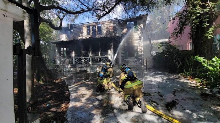 Miami Fire Rescue firefighters deal with a fire at 1016 SW 13th Ct.