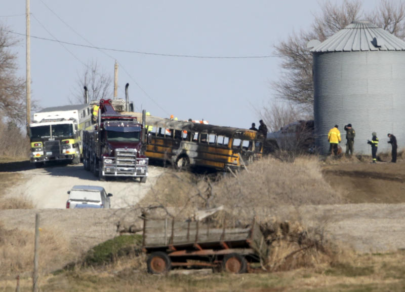 First responders work the scene of a school bus fire in Oakland, Iowa, Tuesday, Dec. 12, 2017. A fire aboard the school bus has killed a student and the bus driver. Investigators say no one else was on the bus when it backed into a ditch and caught fire around 7 a.m. (AP Photo/Nati Harnik)