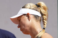 Germany's Angelique Kerber reacts as she plays Ukraine's Anhelina Kalinina during their first round match of the French Open tennis tournament at the Roland Garros stadium Sunday, May 30, 2021 in Paris. (AP Photo/Michel Euler)