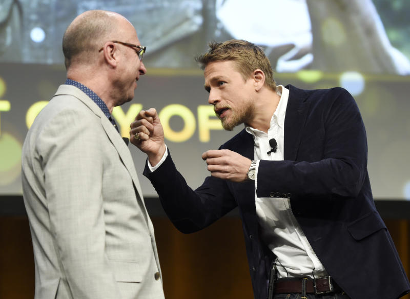 """Charlie Hunnam, right, a cast member in the upcoming film """"The Lost City of Z,"""" interacts onstage with Bob Berney, head of marketing and distribution for Amazon Studios, during the Amazon Studios presentation at CinemaCon 2017 at Caesars Palace on Thursday, March 30, 2017, in Las Vegas. (Photo by Chris Pizzello/Invision/AP)"""
