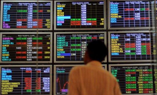 A man monitors shares trading on electronic screens in Kuala Lumpur