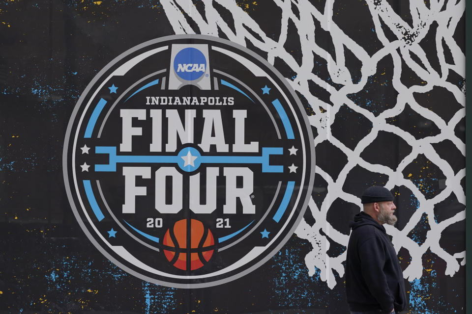 FILE - The NCAA Final Four logo for the NCAA college basketball tournament is painted on a window in downtown Indianapolis, in this Wednesday, March 17, 2021, file photo. The Associated Press has learned that the NCAA has not tested players for performance-enhancing drugs while theyve been at March Madness and other recent college championships. Three people familiar with testing protocols tell AP full-scale testing has not resumed since the coronavirus pandemic shut down college sports a year ago. (AP Photo/Darron Cummings, File)