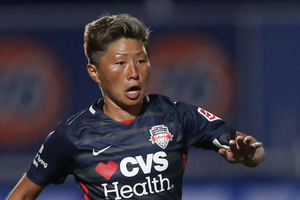 FILE - In this June 27, 2020, file photo, Washington Spirit forward Kumi Yokoyama dribbles the ball during the second half of an NWSL Challenge Cup soccer match against Chicago Red Stars at Zions Bank Stadium, in Herriman, Utah. Yokoyama said they are transgender, a revelation praised in the U.S. where they play in the National Women's Soccer League but an identity not recognized in Japan. (AP Photo/Rick Bowmer, File)