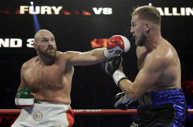Tyson Fury, of England, punches Otto Wallin, of Sweden, during their heavyweight boxing match Saturday, Sept. 14, 2019, in Las Vegas. (AP Photo/Isaac Brekken)