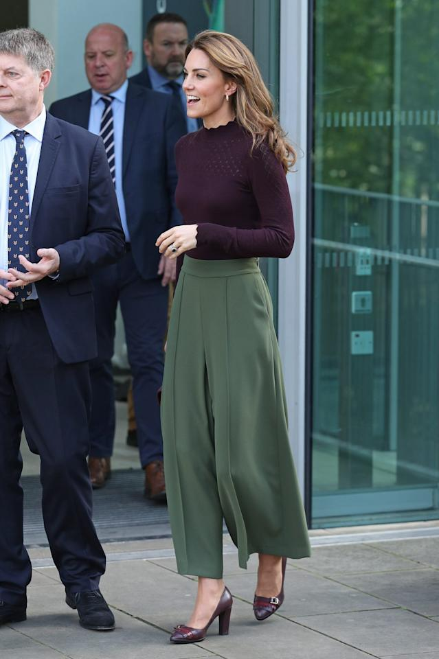 "<p>Kate Middleton embraced fall fashion during an October 2019 visit to the Natural History Museum in London.  She wore an easily replicated look: green khaki culottes from one of her favorite brands, <a title=""(opens new window)"" href=""https://www.jigsaw-online.com/product/Relaxed-Gathered-Waist-Culotte/J39044_GN020"" target=""_blank"">Jigsaw</a>, and a burgundy sweater with a scalloped neckline and sleeves and eyelet detail by <a title=""(opens new window)"" href=""https://www.johnlewis.com/warehouse-wave-pointelle-detail-jumper-berry/p4737083?"" target=""_blank"">Warehouse</a>. She carried a matching deep purple Chanel purse and wore heels in the same color.</p>"