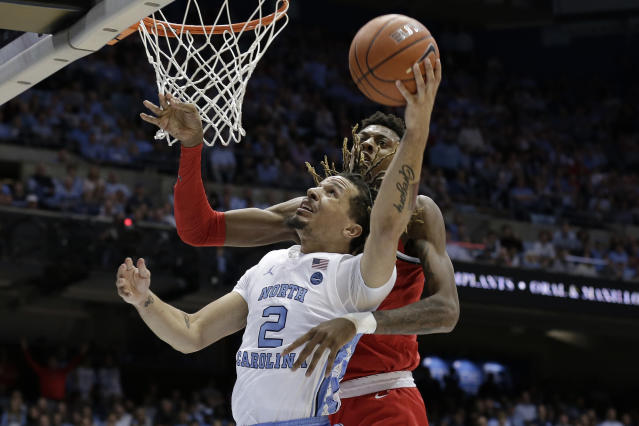 North Carolina guard Cole Anthony (2) drives to the basket while Ohio State forward Alonzo Gaffney defends during the first half of an NCAA college basketball game in Chapel Hill, N.C., Wednesday, Dec. 4, 2019. (AP Photo/Gerry Broome)