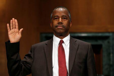 Dr. Ben Carson is sworn in to testify before a Senate Banking, Housing and Urban Affairs Committee confirmation hearing on his nomination to be Secretary of the U.S. Department of Housing and Urban Development on Capitol Hill in Washington, U.S.  January 12, 2017.   REUTERS/Kevin Lamarque