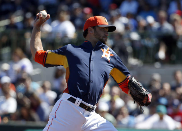 Houston Astros starting pitcher Jarred Cosart (48) throws in the first inning of a spring exhibition baseball game against the New York Yankees, Saturday, March 8, 2014, in Kissimmee, Fla. (AP Photo/Alex Brandon)