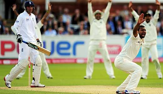 Praveen dismisses Broad to complete his first Test fiver.