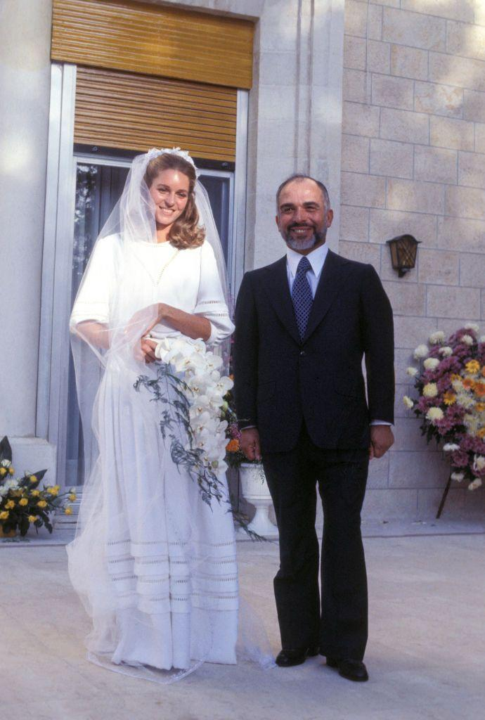 <p>For this royal wedding, Queen Noor al-Hussein, née Lisa Halaby, dressed modestly in an elegant high-neck, tiered gown by Christian Dior. </p>