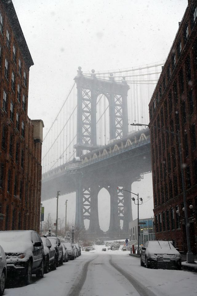 <p>A Brooklyn tower of the Manhattan Bridge is seen from the cobblestone streets of the DUMBO in Brooklyn, New York as a spring storm hit the area on March 21, 2018. (Photo: Gordon Donovan/Yahoo News) </p>