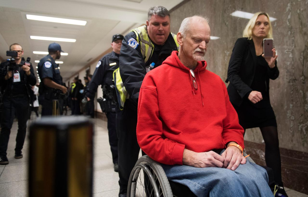 <p>U.S .Capitol Police arrest a protester demonstrating against tax reform outside a Senate Budget Committee hearing on Capitol Hill in Washington, Nov. 28, 2017. (Photo: Saul Loeb/AFP/Getty Images) </p>
