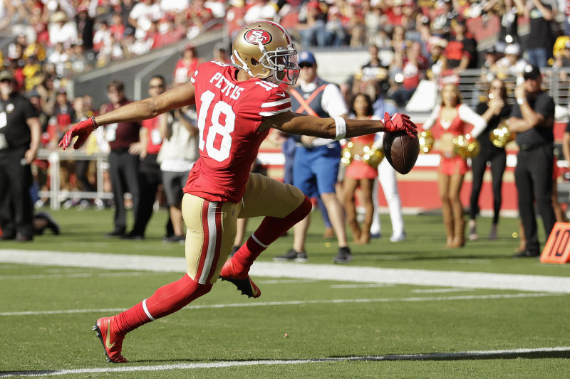 San Francisco 49ers wide receiver Dante Pettis (18) scores against the Pittsburgh Steelers during the second half of an NFL football game in Santa Clara, Calif., Sunday, Sept. 22, 2019. (AP Photo/Ben Margot)