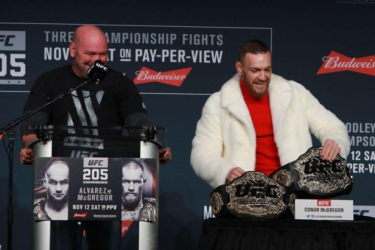 UFC president Dana White (L) laughs with Conor McGregor at a news conference last month in New York. (Getty Images)