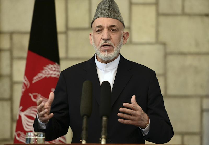 Afghan President Hamid Karzai talks during a joint press conference with British Prime Minister David Cameron at the presidential palace in Kabul, Afghanistan, Saturday, June 29, 2013. Karzai urged Taliban militants to sit down at the negotiating table, saying Saturday his government is still willing to start peace talks with the insurgents despite an attack by the group on the presidential palace this week. (AP Photo/Massoud Hossaini, Pool)