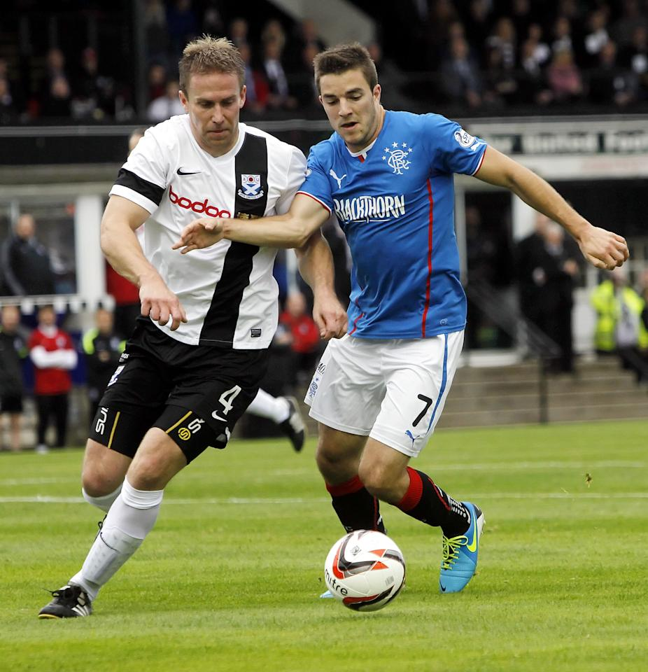Ayr United's Martyn Campbell (left) and Rangers' Andrew Little fight for the ball during the Scottish League One match at Somerset Park, Ayr.