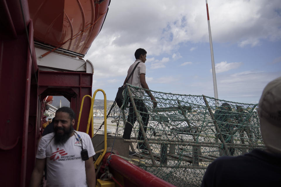 A migrant walks off the Ocean Viking ship docked at the port of Messina, Italy, Tuesday, Sept. 24, 2019. He was among 182 people aboard the Ocean Viking rescued in the Mediterranean Sea north of Libya. (AP Photo/Renata Brito)