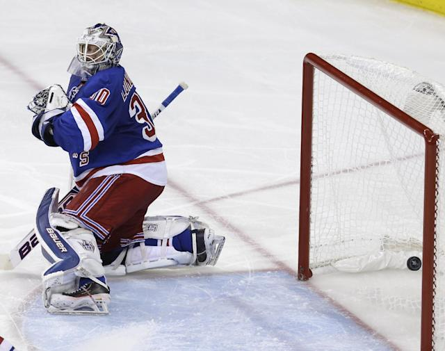 New York Rangers goalie Henrik Lundqvist looks back after being scored on by Montreal Canadiens' Francis Bouillon during the second period of Game 4 of the NHL hockey Stanley Cup playoffs Eastern Conference finals, Sunday, May 25, 2014, in New York. (AP Photo/Seth Wenig)